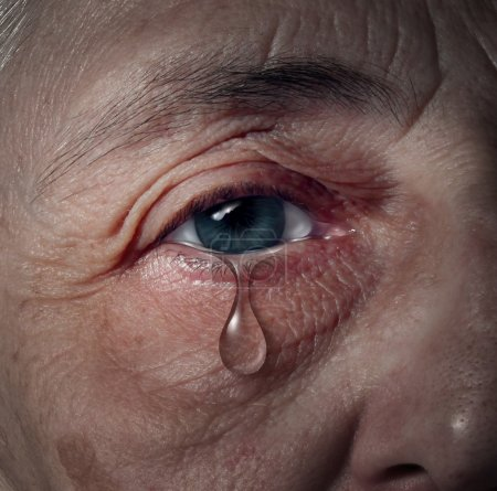 Photo for Senior depression and elderly mental health issues related to loneliness and emotional illness based on grief or chemical imbalance causing anxiety as a close up of an aging human eye crying a tear drop. - Royalty Free Image