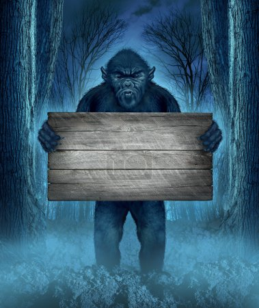 Monster holding a rustic blank old wood sign as a ...