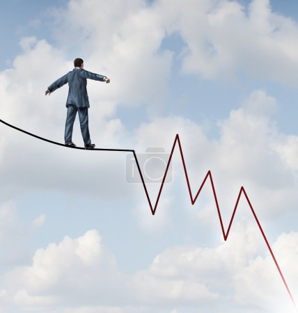 Photo for Losing Profit risk and Investment danger as a financial and business concept or metaphor facing wealth adversity as a businessman walking on a high wire tight rope shaped as a negative and downward stock market sell graph. - Royalty Free Image