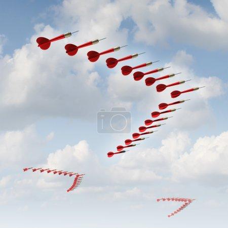 Photo pour Estrategia móvil como un concepto de negocio y la metáfora con un grupo de dardos organizado rojo en una formación de aves migratorias como un símbolo de cambio de rumbo y adaptándose a las nuevas condiciones económicas y buscando nuevas metas y buscando oportunidades. - image libre de droit