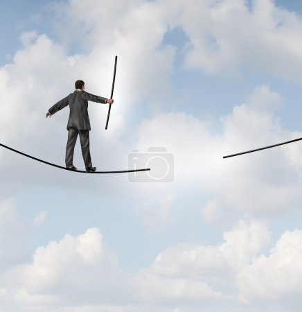 Photo for Risk management solutions business metaphor as a businessman walking on a tight rope or highwire holding the missing piece of rope to complete the journey ahead as a business leadership concept of adapting to change for success. - Royalty Free Image