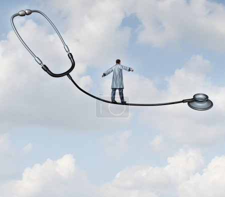 Photo for Medical decisions health care concept with a doctor in a lab coat walking a tight rope made from a stethoscope on a blue sky background as a metaphor for hospital therapy risk versus benefit as a balancing act for successful patient therapy. - Royalty Free Image
