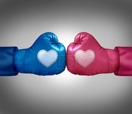 Photo pour Combats pour l'amour et la relation concept argument comme des gants de boxe bleus et roses avec des taches en forme de coeur s'affrontent lors d'une dispute de couple passionné entraînant stress et possible de séparation ou de divorce - image libre de droit