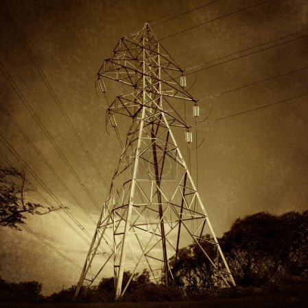 Photo for Electric power tower and electricity distribution network on a grunge vintage texture as a symbol of energy and the electrical grid infrastructure. - Royalty Free Image