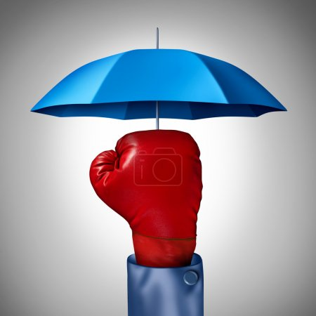 Photo for Competition protection business concept with a red boxing glove from a businessman with a blue umbrella symbol protecting as a defense and buffer safeguard for risk and financial uncertainty. - Royalty Free Image