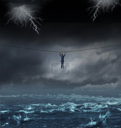 Photo for Surviving the storm business concept with a businessman hanging on to a tightrope crossing over dangerous water as a concept and metaphor for conquering adversity and overcoming challenges. - Royalty Free Image