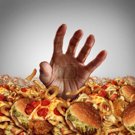 Photo for Obesity and overweight concept as the hand of a person emerging from a heap of unhealthy fast food and desperately reaching out for diet and dieting help as a symbol of bad nutrition proplems. - Royalty Free Image