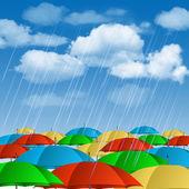 Colorful umbrellas in rain