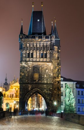 stare Mesto Tower from the Charles Bridge at night, Prague.