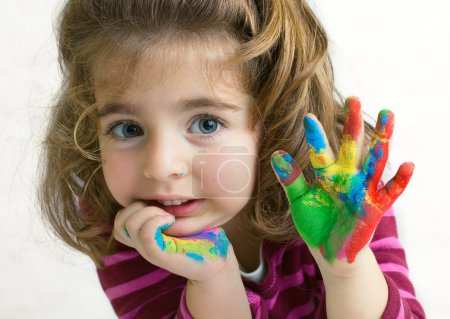 Photo for Preschool girl waving hello/goodbye with her hands painted - Royalty Free Image