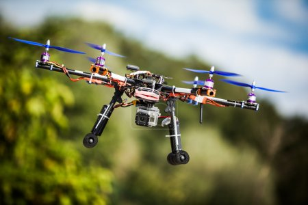 Photo for Professional carbon drone with GPS making a ride. - Royalty Free Image