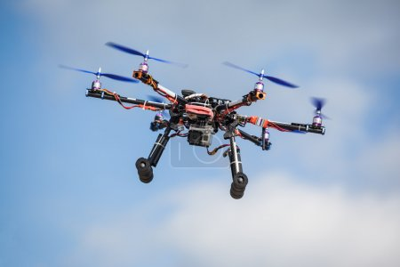 Photo for Professional carbon drone with GPS and video camera making a ride. - Royalty Free Image