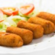 Typical spanish pub food, croquettes with salad....