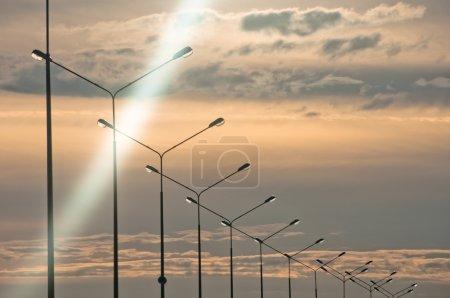 Row of streetlights at twilight