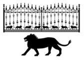 A silhouette of a lion and the iron gates with lions