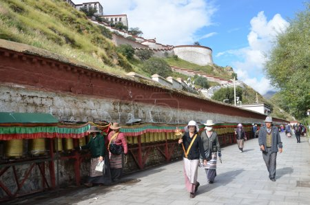 Tibetans commit the bark around the Potala Palace in Lhasa