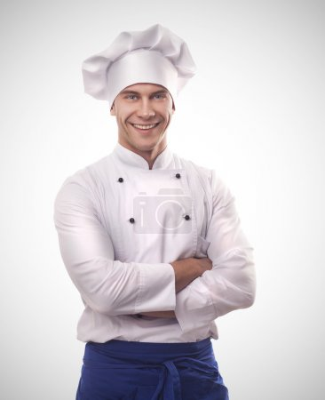 Photo for A male chef isolated over grey gradient background - Royalty Free Image