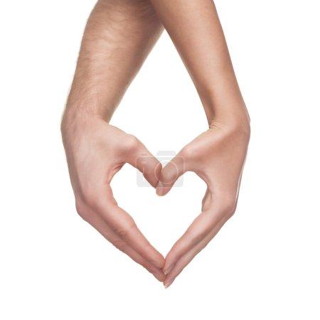 Photo pour Homme et femme de mains montrent coeur geste isolé sur fond blanc - image libre de droit