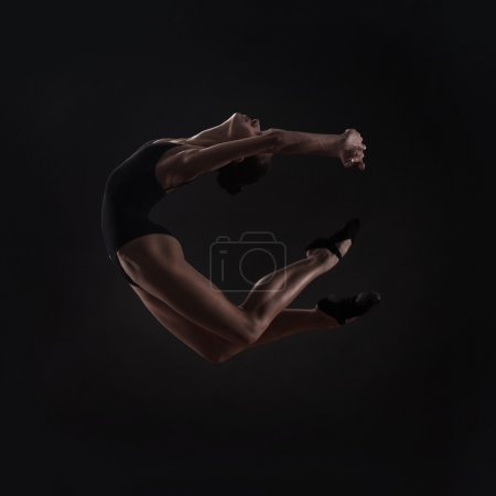 Photo for Beautiful woman ballet dancer isolated on studio black background - Royalty Free Image