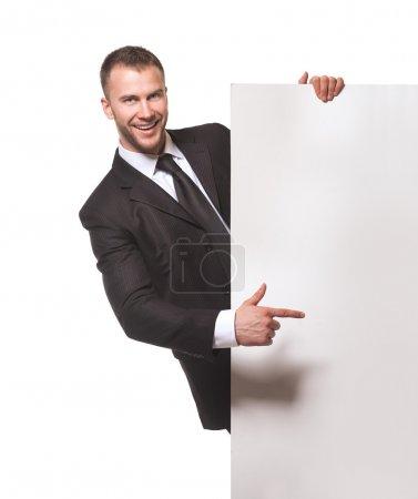 Businessman holding blank billboard