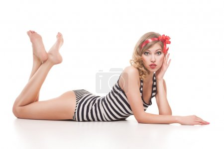 Pinup woman in striped suit on white