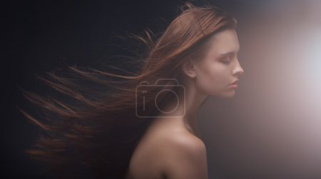Portrait of attractive woman with long hair