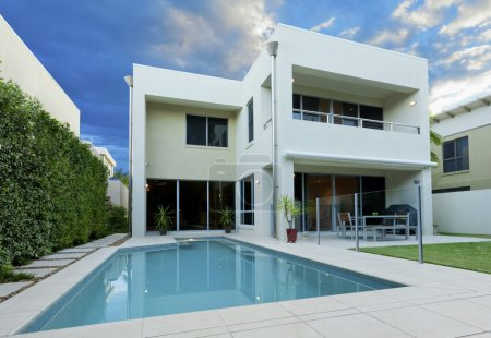 Photo for Luxurious modern house with swimming pool and backyard - Royalty Free Image