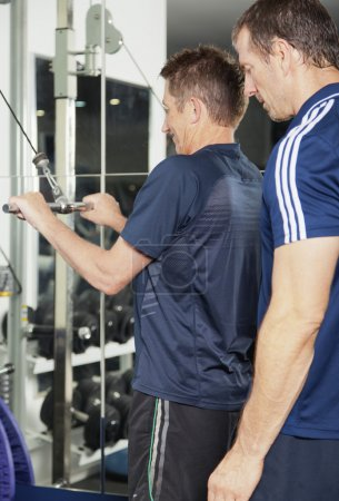 Senior male and PT at the fitness centre