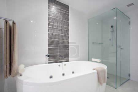 Photo for Stylish clean bathroom with shower and bath tub - Royalty Free Image