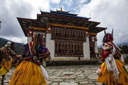 Monks dance in costumes during the Ura Tsechu Festival in Bumthang Valley in Bhutan