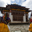 Постер, плакат: Monks dance in costumes during the Ura Tsechu Festival in Bumthang Valley in Bhutan