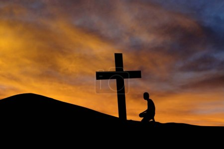A mountain cross and a worshiper