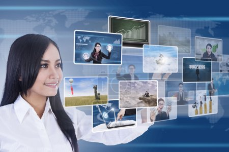 Businesswoman using digital media