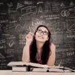College female student is learning in the classroo...
