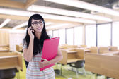 Asian female student calling in classroom