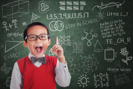 Photo for Cheerful boy student has idea in classroom - Royalty Free Image