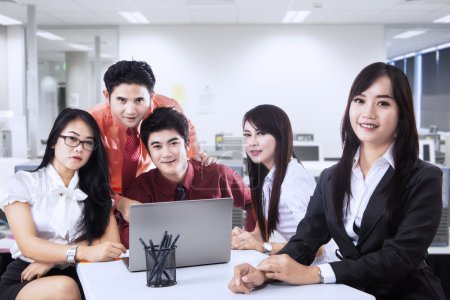 Business manager and team in office