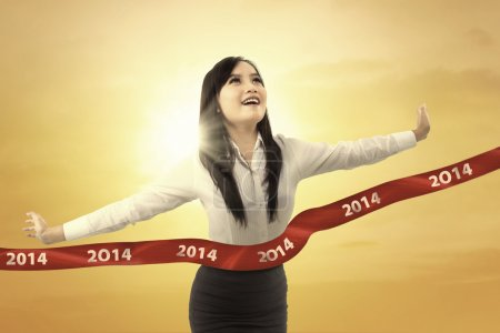 Successful businesswoman crossing the finish line