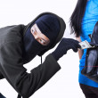 Thief stealing money from handbag of a woman...