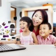 Happy asian family shopping online by using laptop...