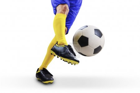 Photo for Closeup of soccer player foot kicking the ball. Isolated on white background - Royalty Free Image