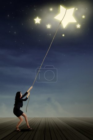 Young businesswoman taking stars