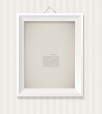 White empty frame hanging on the wall