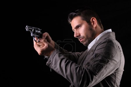 Gangster or private security or detective with a g...