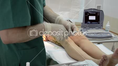 Surgeon operating patient leg