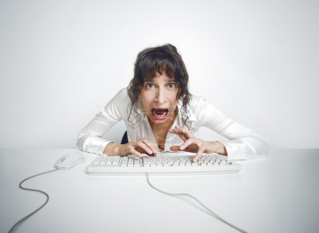 Scared woman at her office desk