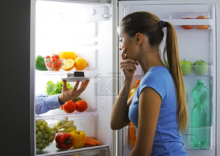 Photo for Woman contemplating if she should ruin her diet - Royalty Free Image
