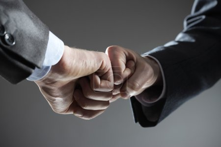 Photo for Business teamwork: two fists touching hand gesture - Royalty Free Image