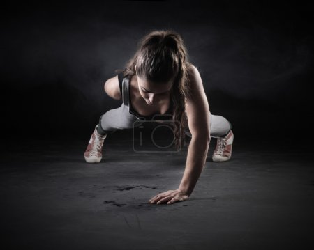 Photo for Young Woman Doing Push-Ups - Royalty Free Image