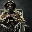 Man in gas mask sitting in a chair...